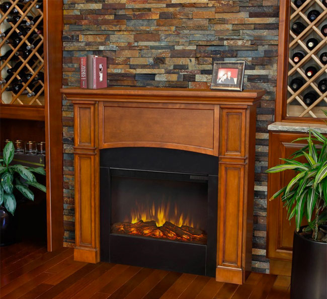 Real Flame Slim Electric Fireplace Against Stone Wall in Living Room